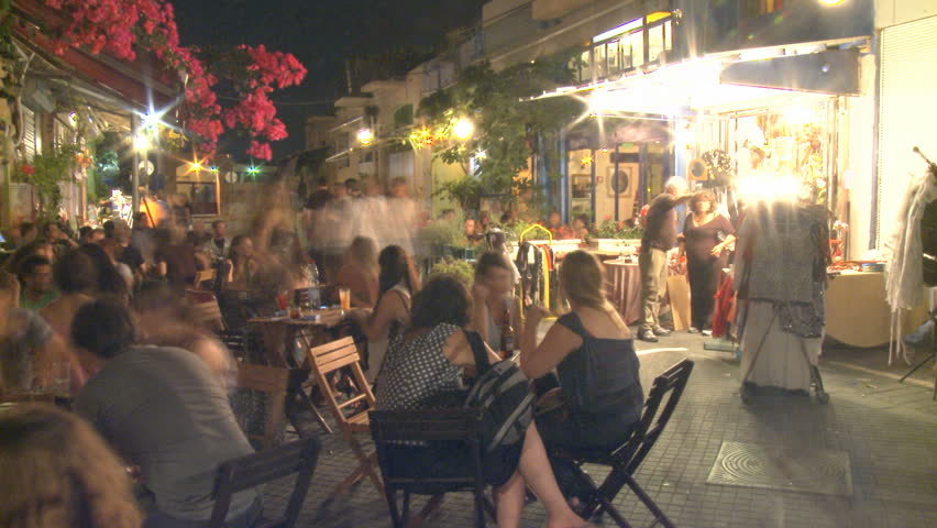Tel Aviv - CIRCA 2011: Time lapse of people enjoying night life at Bar Caffe ,Jaffa, Israel,