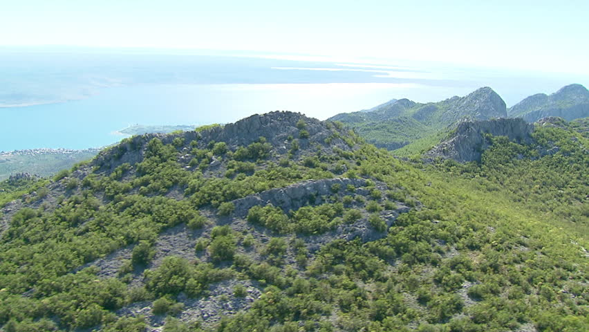 Aerial shot of rocky mountain ridges and view spreading over the Adriatic sea