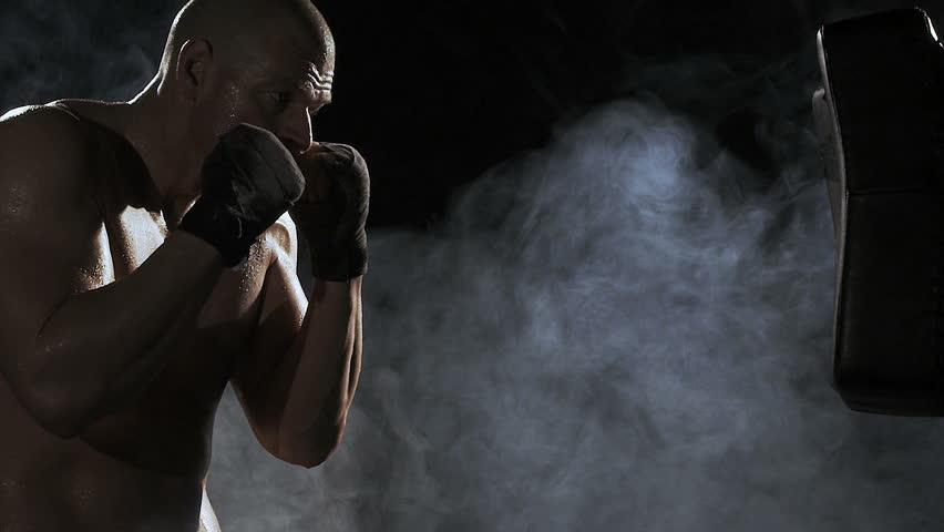 Kickboxer shadow boxing as exercise for the big fight, shot on Red Epic #3673691