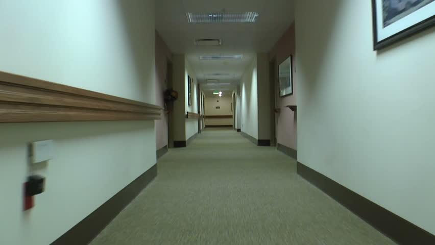 Walk through hallways of clean, elegant elderly care facility. 1080p