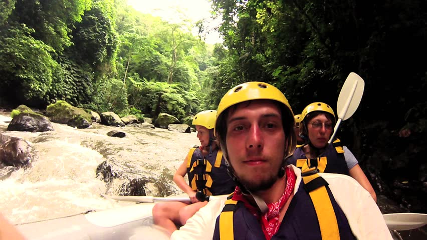 BALI JANUARY 1: Tourists white water rafting in Ayung River, on January 5, 2013 in Bali, Indonesia.