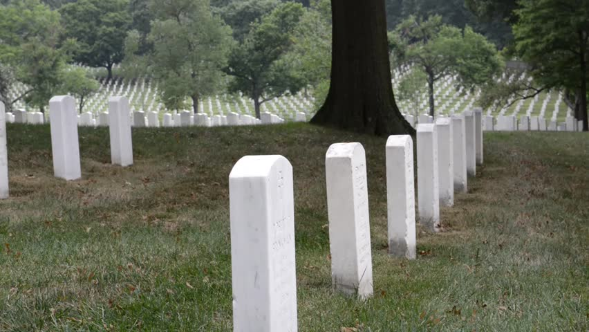 WASHINGTON DC - AUGUST 19: Gravestones on Arlington National Cemetery August 19, 2012 in Washington DC, USA. Veterans from each of the nation's wars are interred in the cemetery.