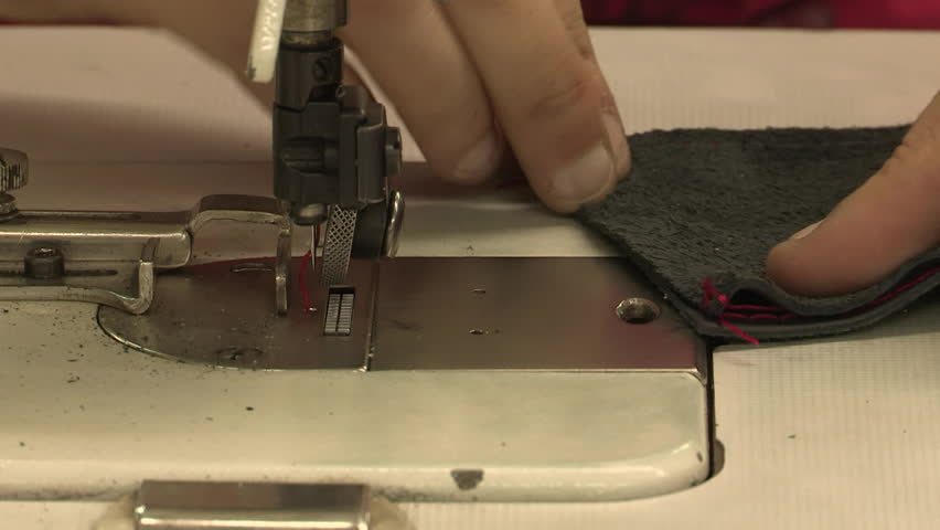 Sewing together two strips of leather
