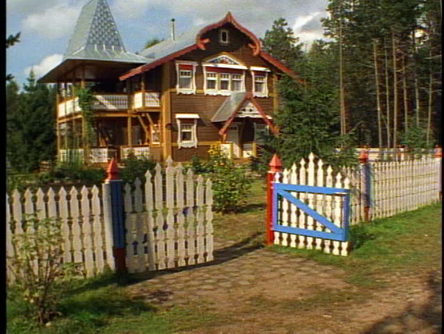 Russian Village houses, quaint, colorful, tilt up, red and silver, gate