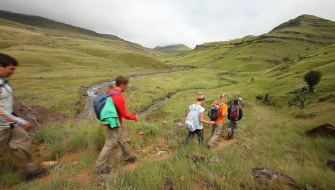 Young group hiking in the Drakensberg,  the highest mountain range in Southern Africa