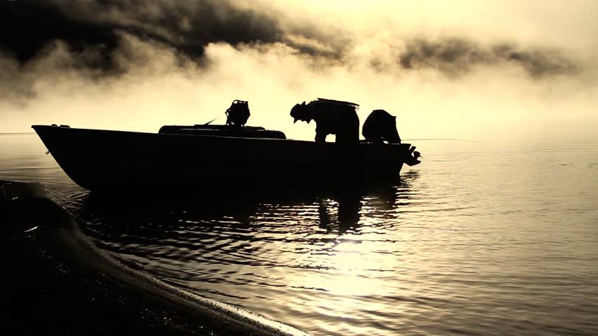 fly fisherman boat dawn