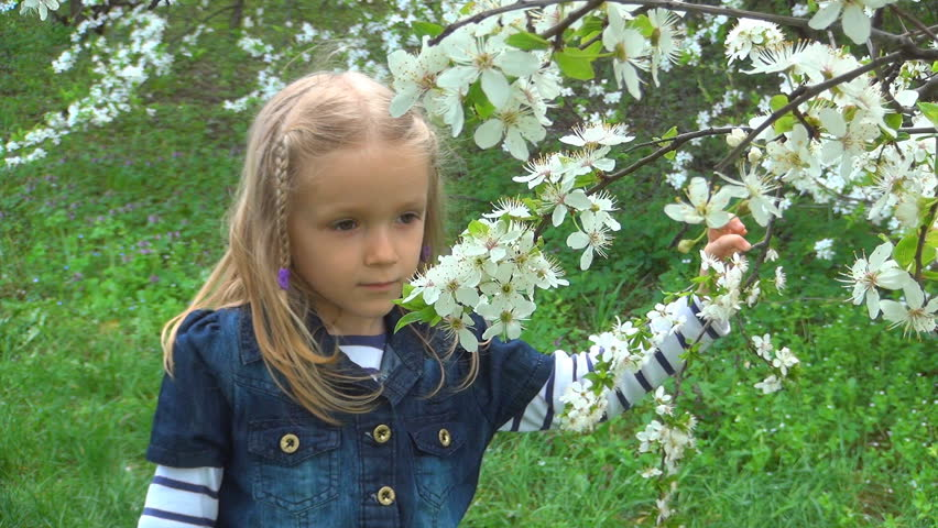 Smiling Child Smelling Spring Flowers Stock Footage Video 100