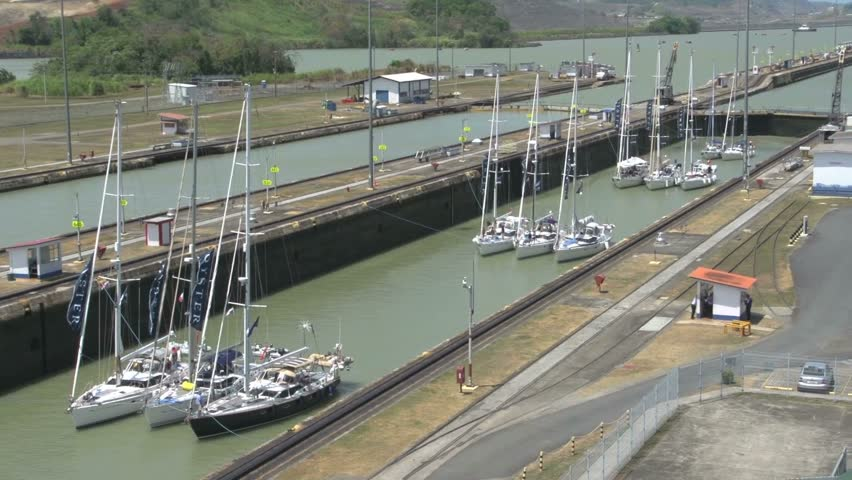 sailboats going down in panama canal hd stock footage clip