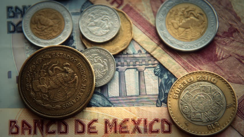 Mexican Pesos 1. Mexican paper and coin currency. Shot at a high frame rate and