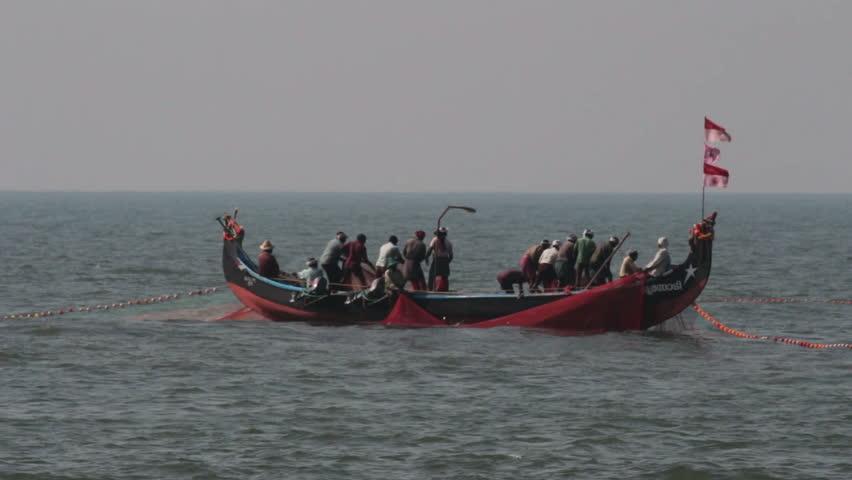 Fishermen In Boats Pulling Fishing Nets - Kerala India Stock ...
