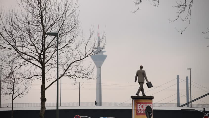 DUSSELDORF, GERMANY – FEBRUARY 28: The Businessman statue by Christoph Pöggeler is a symbol of the city present status as a powerful economic center.  February 28, 2013,  Düsseldorf, Germany