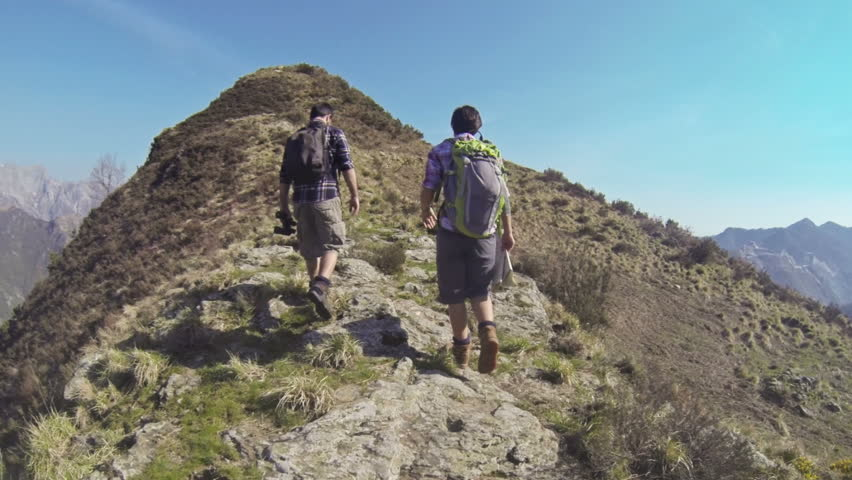 Young Couple Walking in the Mountains   Shutterstock HD Video #3761249