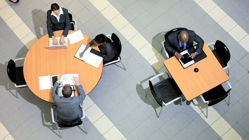 Overhead view of groups of multi ethnic business people holding meetings | Shutterstock HD Video #3772097