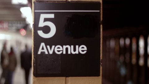 DOLLY: 5th Avenue Subway, NYC - a dolly shot revealing a subway train arriving at the 5th Avenue subway station
