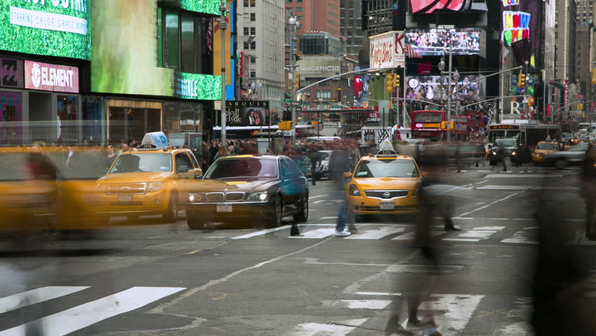 NEW YORK - CIRCA APRIL 2013: Crowd of people walking busy street timelapse