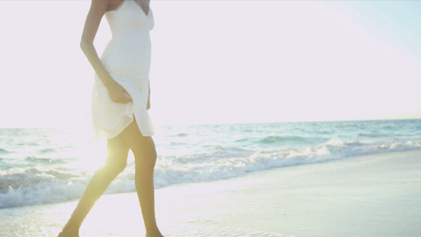 Beautiful carefree girl enjoying her beach lifestyle by ocean sun lens flare shot on RED EPIC | Shutterstock HD Video #3789653