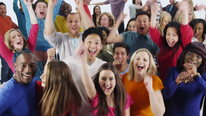 Portrait of a happy and diverse multi ethnic group of people who are standing together, in brightly colored casual clothing and having fun. They are isolated on white in a studio shot.  | Shutterstock HD Video #3813710