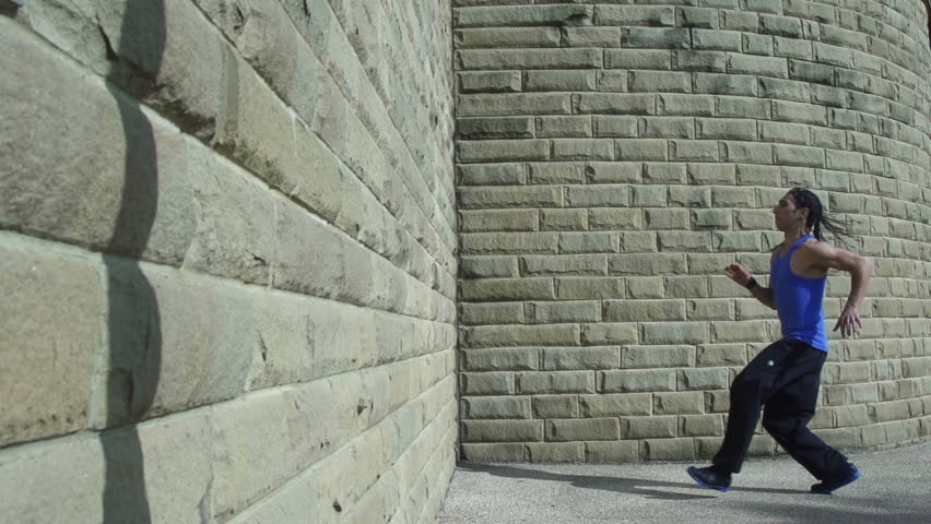 Backflip - A free runner back flips off a wall in super slow motion #3843278