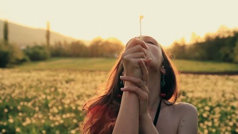 Beautiful Young Woaman Blowing Dandelion Laughing on a Summer Field HD