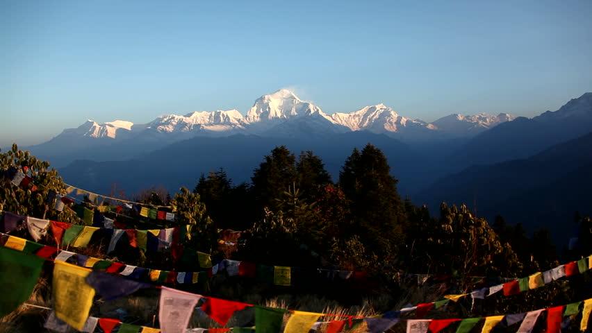 Himalayan Mountain Peak Buddhist Prayer Flags In Nepal. Dhaulagiri is 8167m or
