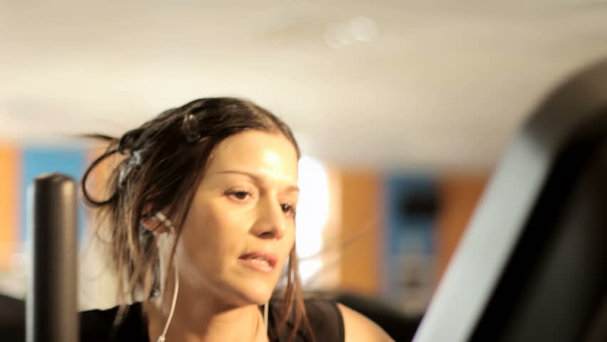 JIB: Walking Machine - a woman exercising in the gym