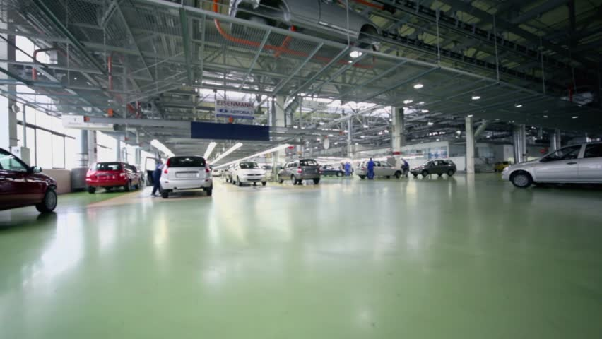 TOGLIATTI - SEP 30: Hangar with production line of Lada Kalina cars at factory VAZ, (shown in motion) on September 30, 2011 in Togliatti, Russia. AvtoVAZ sold more than 530000 cars in Russia at 2012.