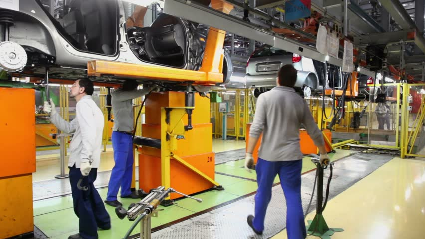 TOGLIATTI - SEP 30: Workers assemble cars Lada Kalina at factory VAZ, September 30, 2011, Togliatti, Russia. Lada Kalina took first place in number of cars sold in Russia at first five months of 2011