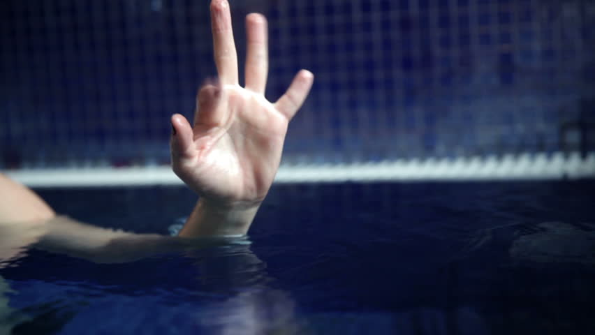 Close up shot of a waving woman hand in the pool | Shutterstock HD Video #3852929