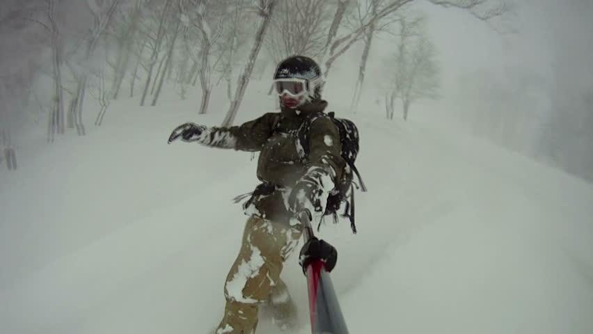 Extreme Snowboarder Blasts Through Backcountry Powder Snow. Snow flies