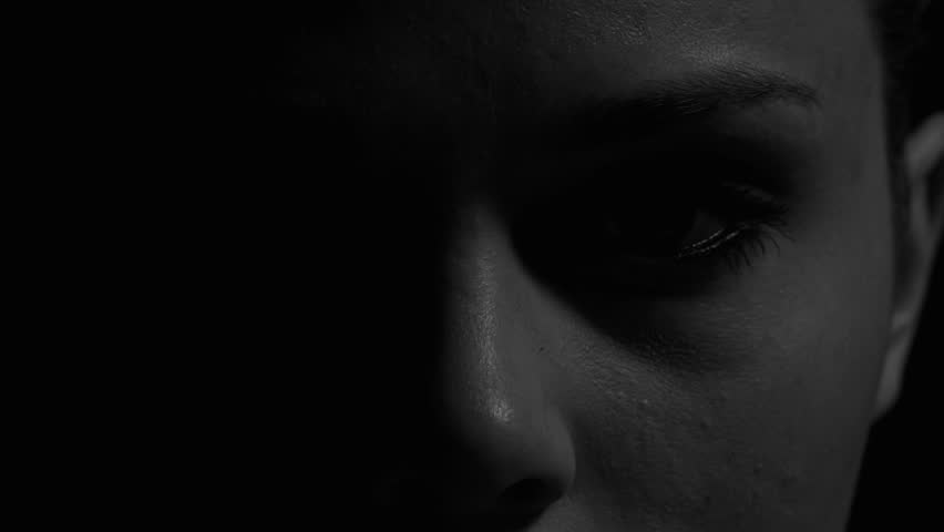 Woman's eyes in black and white. Experimental lighting.