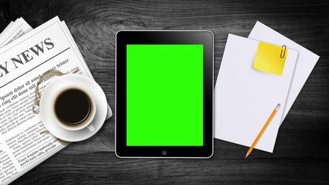 Hand Gestures on a tablet with green screen  and morning coffee