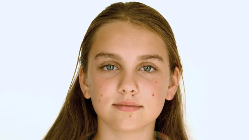 Girl smiling against white background in slow motion at 500 frames per second