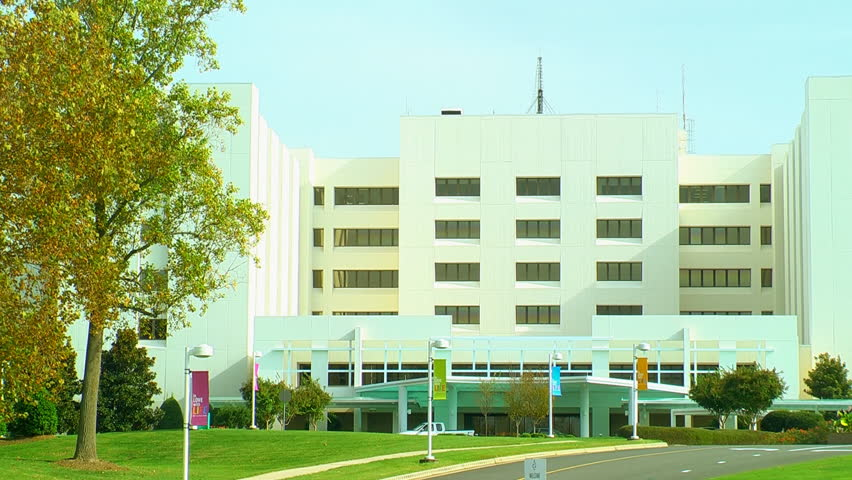 The entry way to a white hospital building - HD stock footage clip