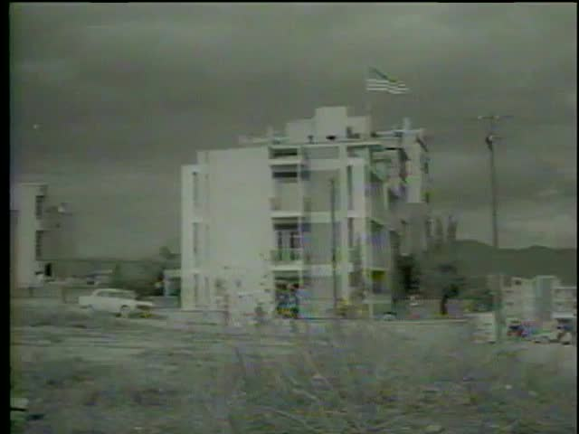 Destroyed US embassy after two bombs explosions in Cyprus, circa 1964-MGM PICTURES, UNIVERSAL-INTERNATIONAL NEWSREEL, USA, filmed in 1964   | Shutterstock HD Video #3876449