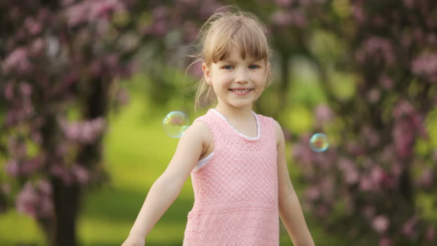 Girl spinning in park and smiling  #3878588