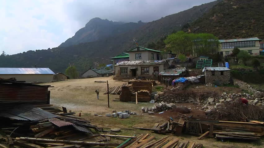 Villagers walk around their small Sherpa village at the edge of Namche Bazaar, on the way to Mt. Everest.