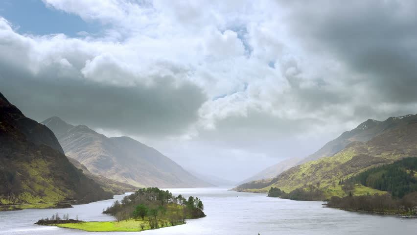 Time lapse video of Scottish highland scenery. Sunrays sweeping through the clouds. #3926789