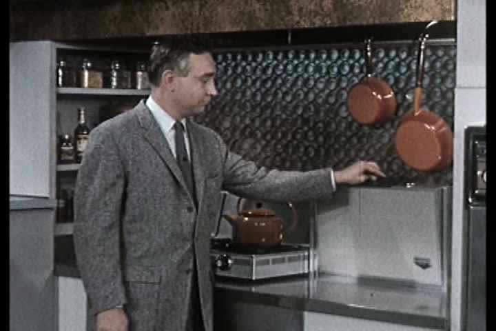 1950s - A couple is given a tour of an amazing new modern kitchen in 1959.