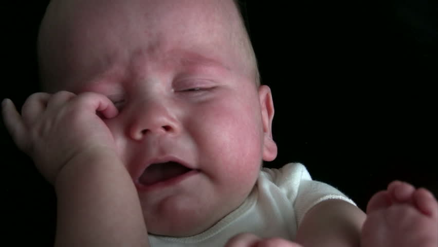 Baby crying and seeming very upset.  HD 1080i