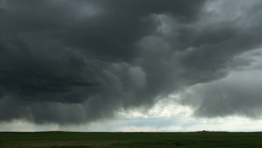 Large thunderstorm moves over the eastern plains of Colorado, on the same day