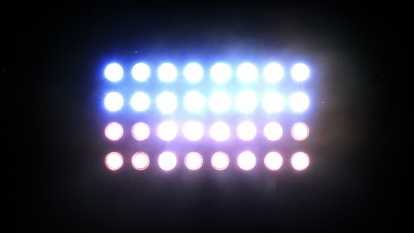 Bright floodlights turning on and off forming different shapes. Amber and blue.  SEE MORE COLOR OPTIONS IN MY PORTFOLIO.