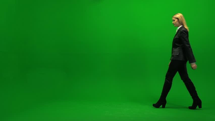 Blond Women Walking Trough Frame Against Green Screen -6425