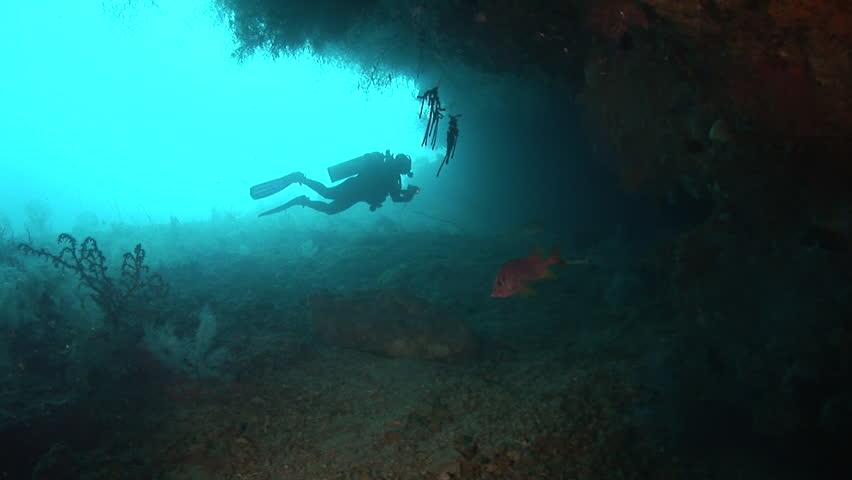 Diver enters a cave, backlight shot | Shutterstock HD Video #3956534