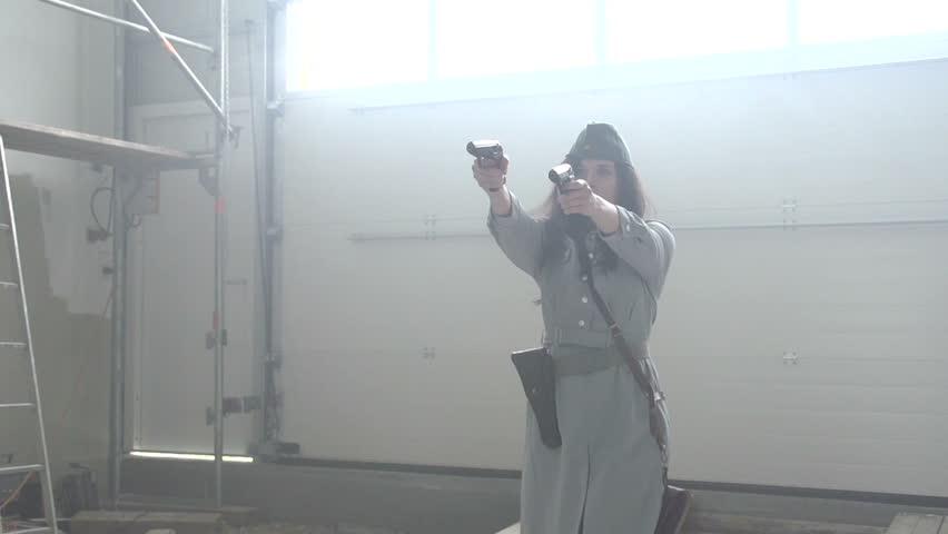 Female officer shooting 2 pistols in slow motion