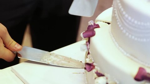Cutting and folding plates on the wedding cake
