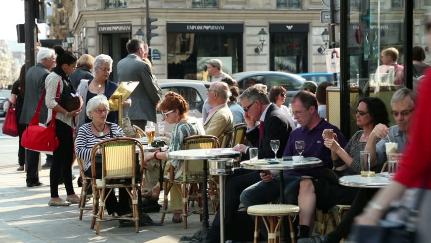 PARIS - APRIL 26: Unidentified people sit at Paris cafe, Deux Magots on April 26, 2013 in Paris. Intellectuals and writers like Jean-Paul Sartre and Ernest Hemmingway were patrons of this cafe.