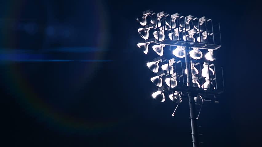 Stadium Lights turn on at sporting event. #3985420