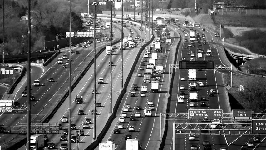 Traffic on highway 401. Longshot with heat shimmer. Toronto, Canada.  | Shutterstock HD Video #399046