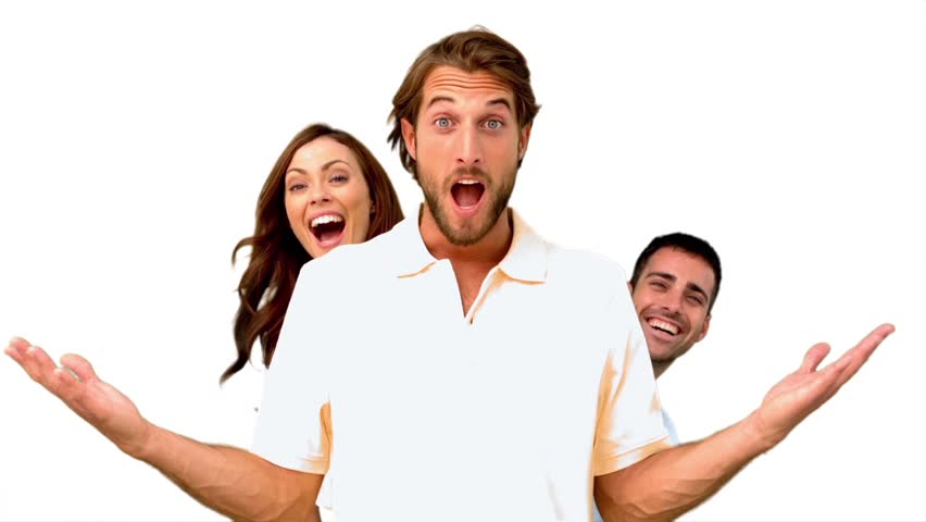 Friends hiding behind a man on white background in slow motion