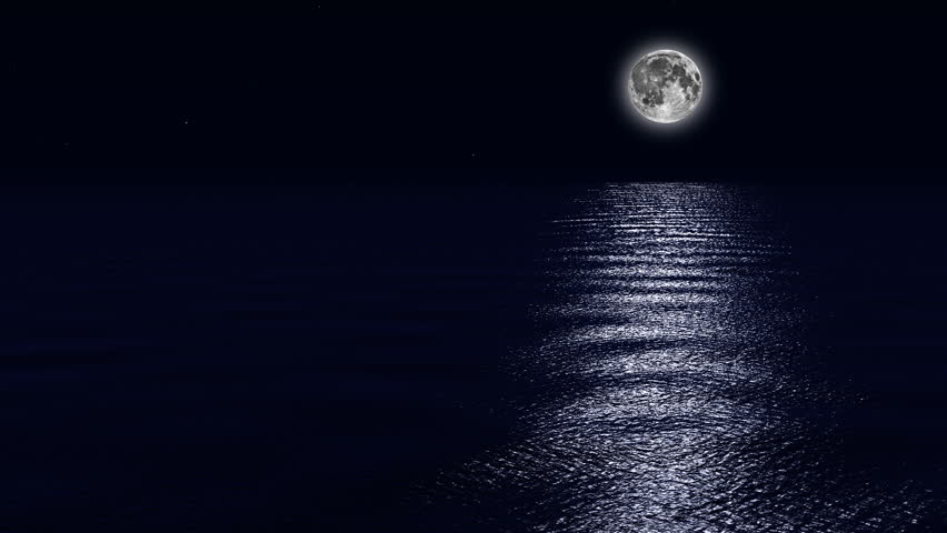 Full moon in a clear night sky with the stars twinkling over a calm ocean. Seamlessly loops.